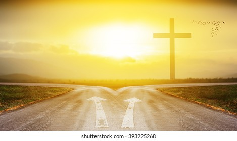 cross with road and sunlight background with shadow edge