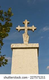 Cross of Santiago on a pedestal. Symbols on the Camino de Santiago -