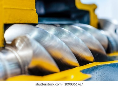 Cross section of the air compressor. Rotor of air screw compressor. Close-up photo. Shallow depth of field.