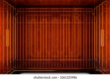 A cross section birds-eye view of the inside of an empty hot operational household oven with a glowing element and metal rack - 3D render