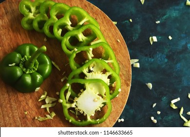 Cross Section and sliced Green Capsicum on the wooden backdrops Royalty free Stock Photos and Images