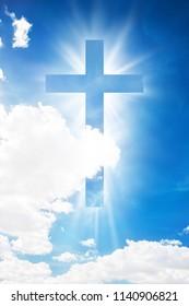 Cross shape shining in cloud blue sky. Christian conceptual image background
