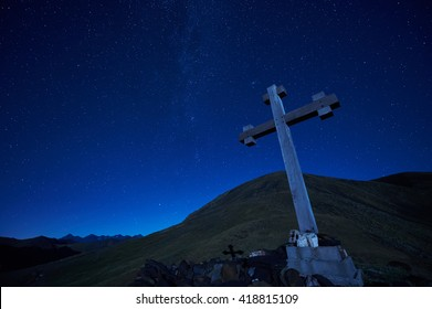 cross sign on the mountain peak pass at night