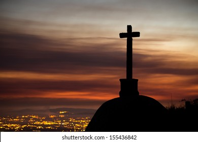 cross silhouette and a dramatic sunset
