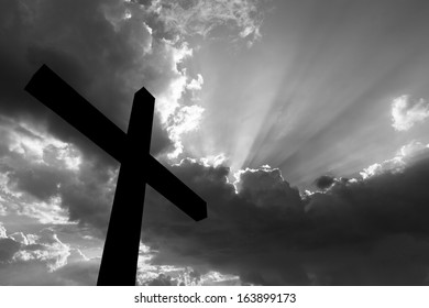 Cross silhouette and the holy  sky black and white