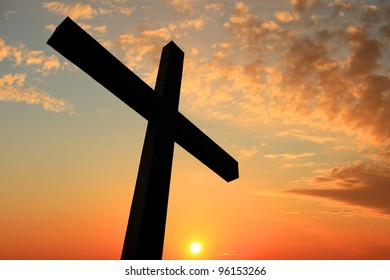 Cross silhouette and the holy twilight sky