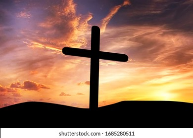Cross silhouette with sunset background