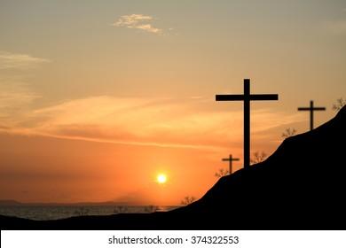 Cross silhouette. Sunset background.