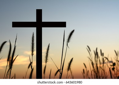 Cross silhouette, sunset background