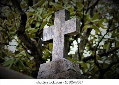 A cross sits atop a religious relic.