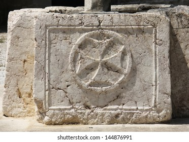 Cross symbol sign of Saint John knights graved in stone