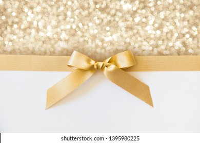cross thin gold ribbon with bow, isolated on white