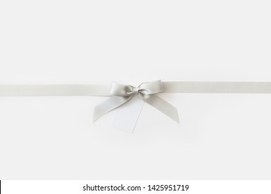 cross thin silver ribbon with bow, isolated on white