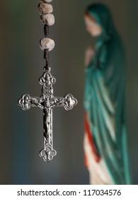 Cross with virgin Mary, closeup, for religious,spiritual themes