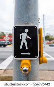 Cross Walk Sign and Button at a city intersection