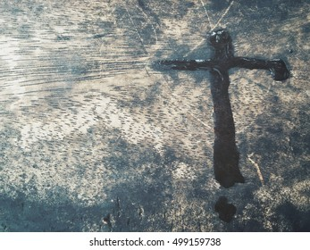 Cross of water stain