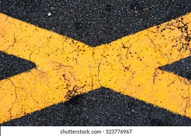 THe cross yellow line on asphalt
