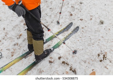 Cross-country skiing plastic close-up. On the snow lie leaves