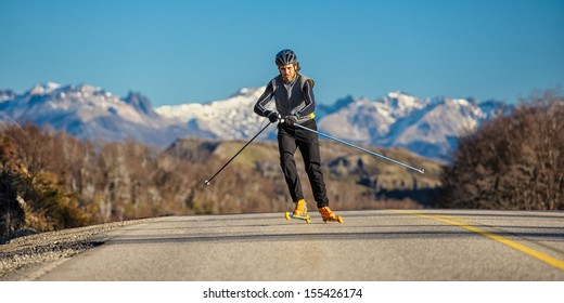 cross-country skiing with roller ski and mountain background