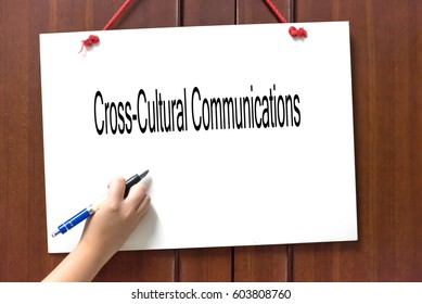 Cross-Cultural Communications -  Hand writing word to represent the meaning of Business word as concept.
