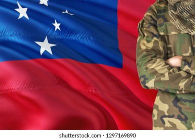 Crossed arms Samoan soldier with national waving flag on background - Samoa Military theme.