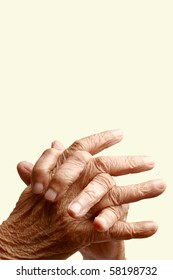 Crossed  fingers of an old asian woman