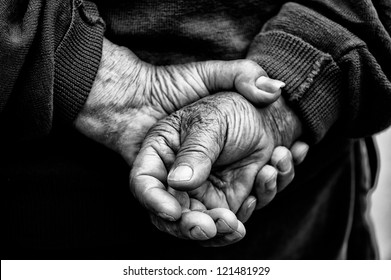 Crossed Hands in black and white of old retired man who had worked hard in his life as farmer