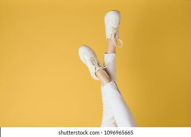 Crossed legs in sneakers