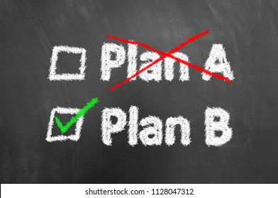 Crossed plan a ticked plan b chalk text on chalkboard or blackboard with check boxes as successful backup alternative solution concept