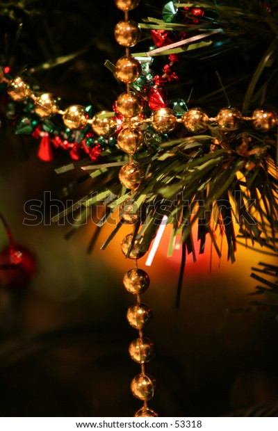 A crossed string of beads on a christmas tree