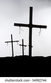 Crosses against the light on a hill