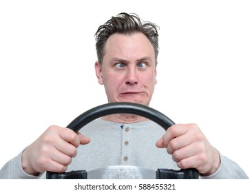 Cross-eyed funny man driver with steering wheel isolated on white background