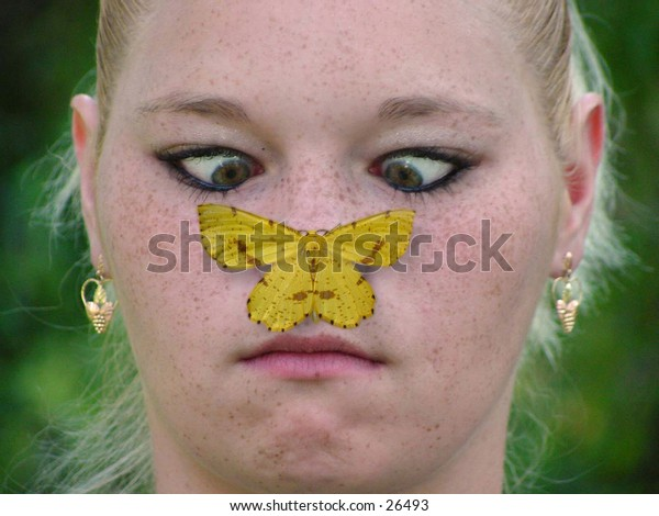 Cross-eyed girl with a butterfly on her nose