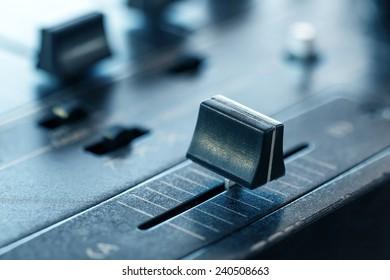 Crossfader on dj mixer in club, closeup