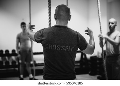 crossfit group training. Man and woman group training indoors. Black and white