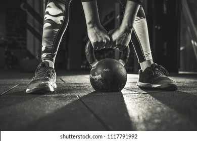 Crossfit kettlebell training in gym. Woman doing crossfit workout
