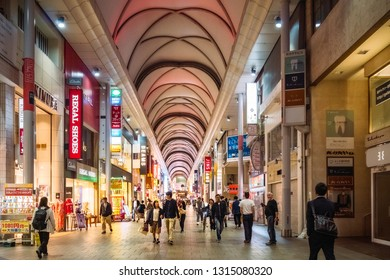 Crossing Arcade, Hiroshima, Japan -November 6, 2018: People shop in a covered City Street in downtown Hiroshima, Chugoku District, Japan.