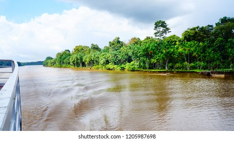 Crossing by ferry boat from Macapa to Belem by Amazon River, passing lush, green jungle and indigenous villages, from state of Amapa to state of Para in Brazil