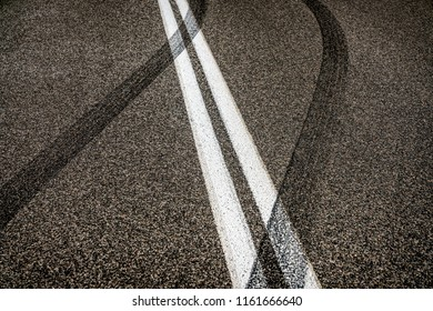 Crossing double lines braking traces on roadway