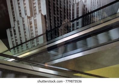 Crossing Escalator with Skyscraper in the Back