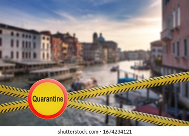 Crossing fencing lines with warning sign of quarantine on the blurred background of Grand Canal in Venice, Italy. Coronavirus, Covid 19 pandemic, Quarantine concept.