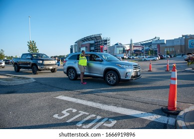 crossing guard directing traffic at public event on September 21, 2019 in Foxboro outside Gillette stadium Massachusetts.