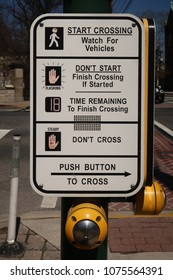 Crossing guard sign and buttons.