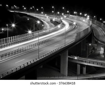 Crossing highway with car and lamp lights at night