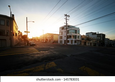 Crossing of two streets in San Francisco during sunset.