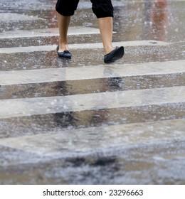 Crossing the zebra crossing in the rain
