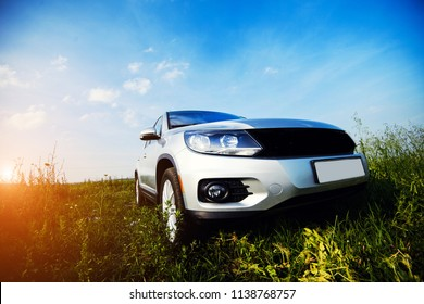 crossover SUV in the countryside with sunset in the background.
