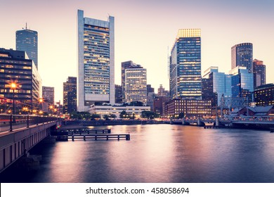 Cross-processed photo of Boston in Massachusetts, USA at sunset showcasing its mix of modern and historic architecture.