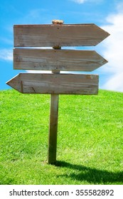 Crossroad wooden directional arrow signs outdoor in the meadow