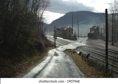 Crossroads and RR intersection of tiny coal mining town on a rainy day
